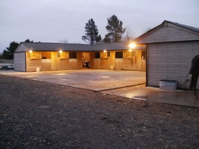 The stables lit up at night